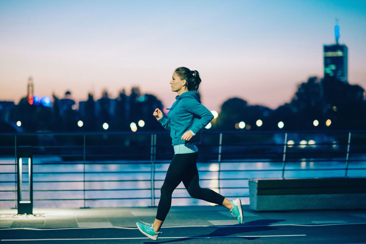City City Life Exercising Girl Power Jogging Time Lifestyle One Person Only Woman Dusk In The City Fit Fitness Healthy Lifestyle Jogging Night One Person Outdoors Running Sports Clothing Sporty Strength Sunset Toned Image Urban