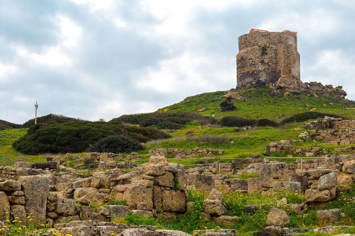 Ancient tower over Tharros Holiday Travel Tower Ruins Ancient Ruins Evening History Ancient Roman Tharros Oristano Cabras History Cloud - Sky Old Ruin Business Finance And Industry Castle Architecture Outdoors Rural Scene Day No People Ancient Civilization Sky