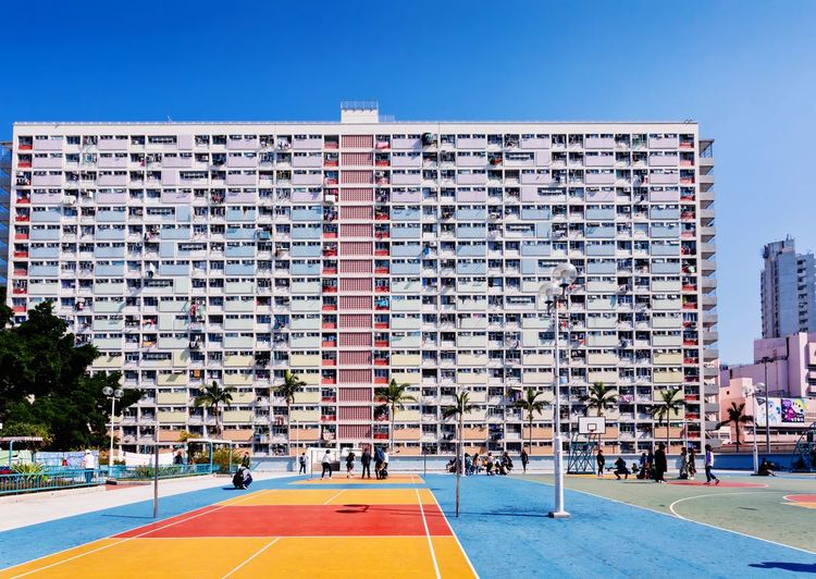 Rainbow Village, Hong Kong Landscape Urban Style Tourist Attraction  Blue Sky China HongKong Tourism Skyscraper Prosperous City Color Modern Special Administrative Region Cityscape Scenery Bustling Development Of Building Rainbow Village, City Ice Hockey Sky Architecture
