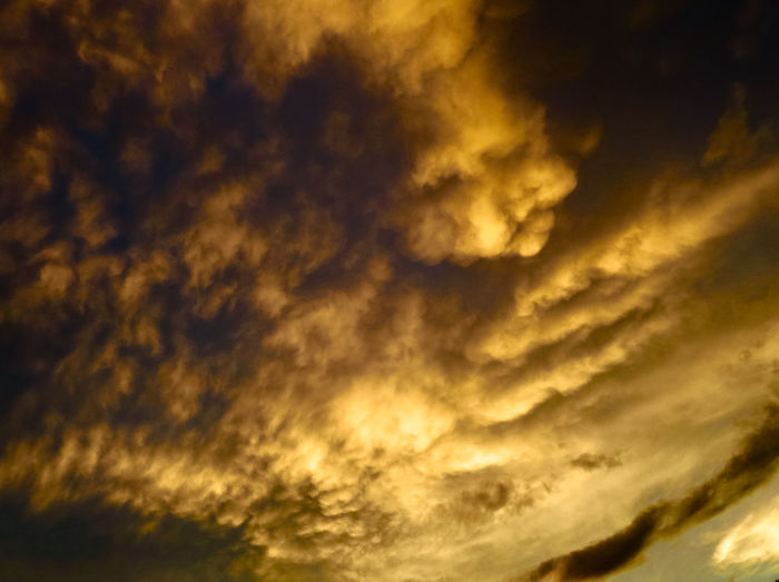 Stormy Clouds Cloud - Sky Scenics - Nature Cloudscape Beauty In Nature Sky Dramatic Sky Nature Overcast Low Angle View No People Outdoors Awe Power In Nature Meteorology Sunset Golden Clouds