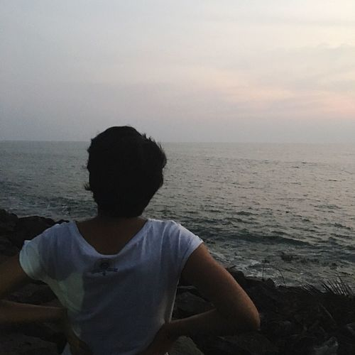 Contemplation perhaps. Sea Horizon Over Water Water Scenics Nature Beauty In Nature After Sunset Dark Contemplating Hands On Hips Back Shot  Turn Around Looking Forward Mobilephotography Lifestyles Tranquil Scene Sky Tranquility Vacations Outdoors