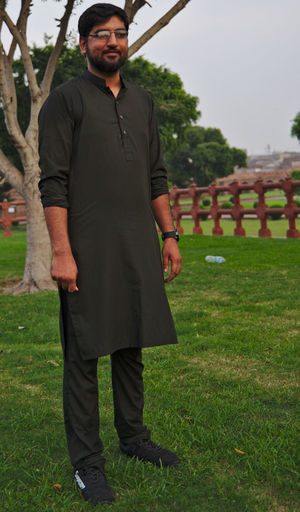 Young man standing on field
