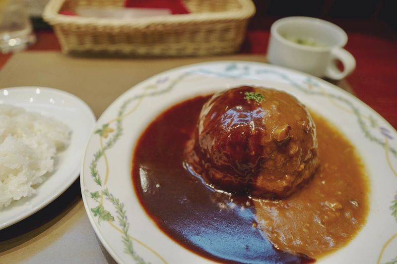 OSAKA EAT : big-size Cabbage roll on Dish, Continental cuisine Grill Maruyoshi, Abeno Osaka. demi-glace & curry sauce mariage. 大阪市 阿倍野 グリルマルヨシ 特製ロールキャベツ ロールキャベツ LEICA Q Typ116 28mm F/1.7 Japanese Cuisine 夜食テロ 飯テロ Yoshoku Cabbage Roll On The Plate Food And Drink Ready-to-eat Food Indoors  Serving Size Table