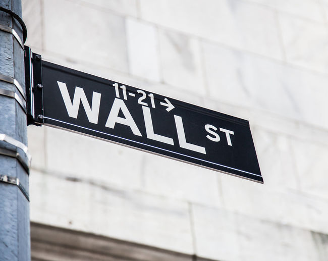 Low Angle View Of Wall Street Sign