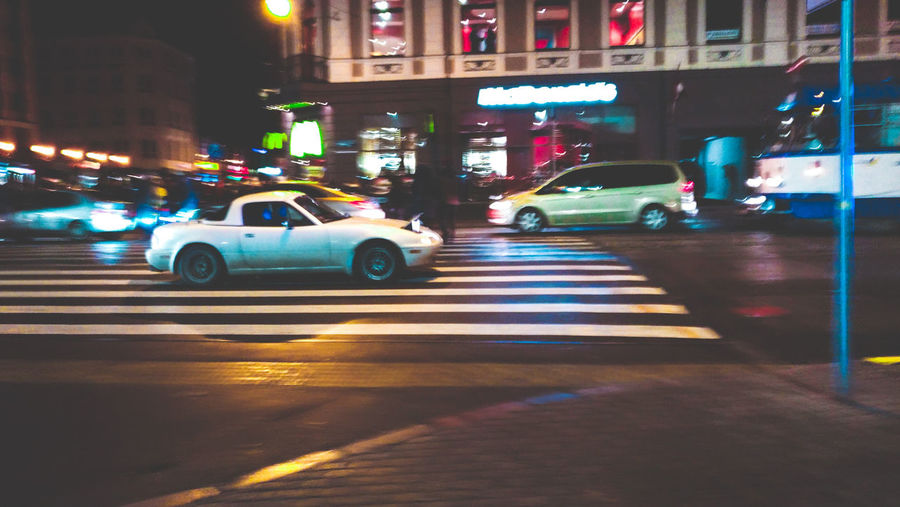 Traffic Mx5 Popup Mazda Riga Latvia Centre Vecriga Car Cars Carspotting Urban Photography Car Photographer Speed Motion Car City City Street Night Street Traffic Taxi Transportation Mode Of Transport City Life Yellow Taxi Illuminated Outdoors People