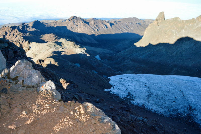 Glaciers above the clouds in the volcanic landscapes at mount kenya