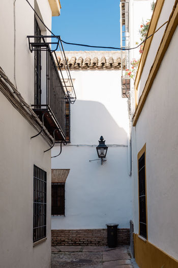 Narrow street in historic centre of Cordoba Córdoba Spanish Typical Architecture Balcony Building Exterior Built Structure Centre Day Jewish Quarter Jewry Narrow Street No People Outdoors Residential Building Street Town White Wall Window