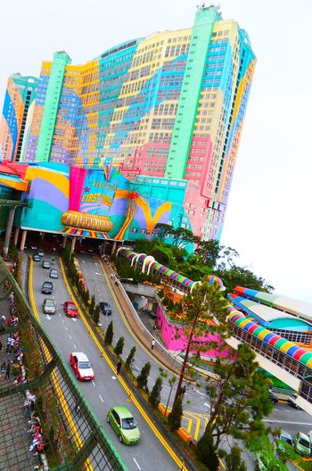 A STREET VIEW IN MALAYSIA City Multi Colored Cityscape Sky Architecture Vehicle Moving Skyscraper High Street Skyline