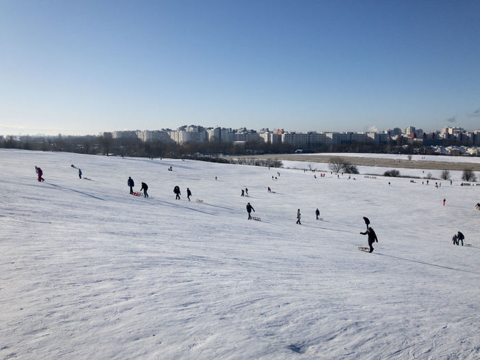 Group of people on snow covered land