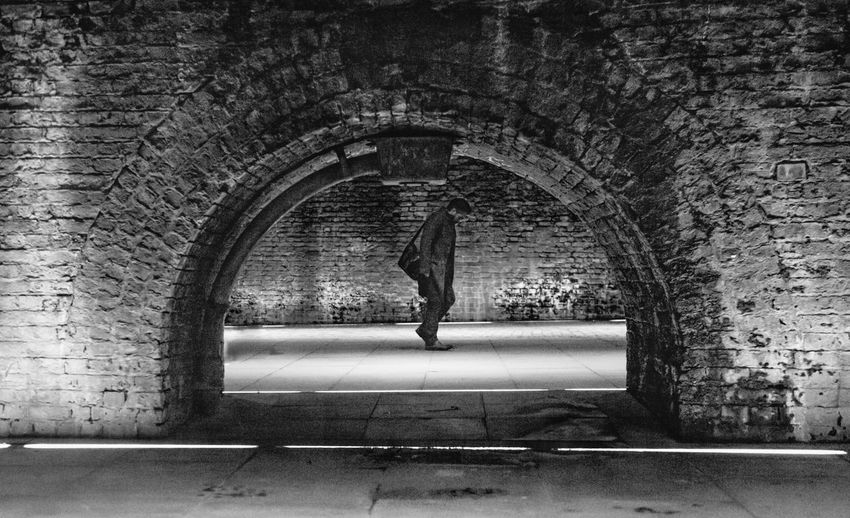 Stooped Head Depression - Sadness Looking Down Moody Man Lone Figure Full Length Tree Women Arch Architecture Built Structure Under Arched Architecture And Art Historic Passageway Below Archway Low Section Exterior Wall