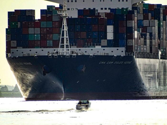 David Vs Goliath Ship Boat Transportation Nautical Vessel Sea Day Outdoors No People Architecture Water