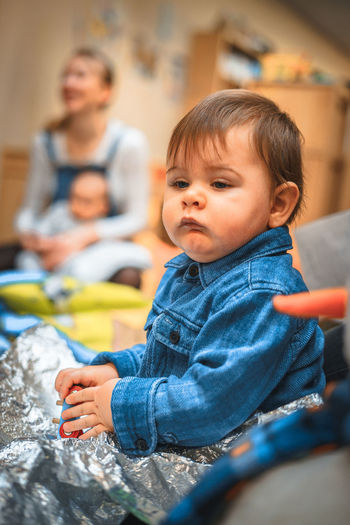 Serious Seriousface Babyboy Baby Boy Babyhood Boys Childhood Close-up Denim Focus On Foreground Indoors  Play Playground Playing Silver Colored Sitting Son