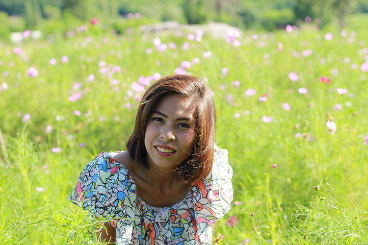 Portrait of beautiful woman lying on flower