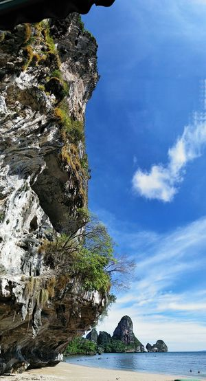 Ton Sai Beach Climbing on Perfect Limestone. Climbing Limestone EyeEm Selects Sea Beach Sand Mountain Rock - Object Blue Sky Seascape Cliff Shore
