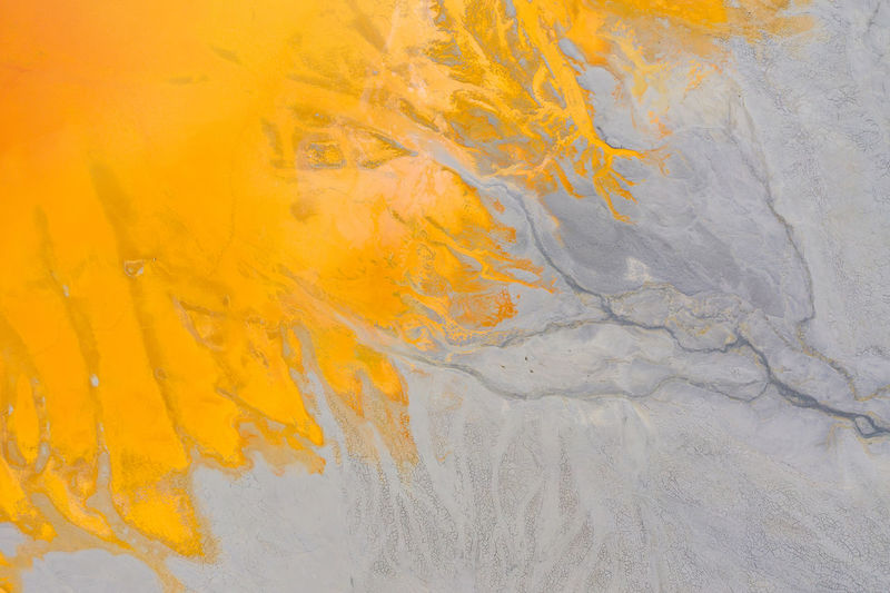 Colorful lake polluted with yellow waste water, aerial view of a mining decanting pond with toxic red residuals from copper exploitation from drone. Geamana, Rosia Montana, Romania Yellow Full Frame Backgrounds Textured  No People Close-up Nature Outdoors Orange Color Day Aerial View Aerial Aerial Photography Aerial Shot Aerial Landscape Drone  Dronephotography Drone Photography Droneshot Yellow Color Abstract Abstract Backgrounds Abstract Photography Open Pit Mine Open Pit Copper Mine Copper Mines Copper Mine Waste Toxic Toxic Substance Waste Environmental Damage Lake Mud Geological Geological Landscape Cyanide Cyanide Lake Destruction Destruction Can Be Beautiful Flow Of Water Industrial Mining Poison Pollution Pollution In My World Pollution Of The Environment Romania Geamana Rosia Montana