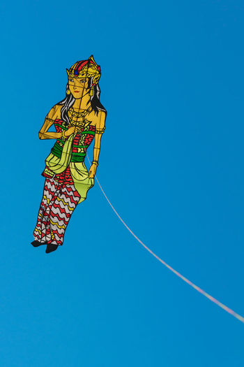 Outdoors Blue Sky Blue Background Copy Space Backgrounds Cultures Women women around the world Freshness Day Colors Mid-air Kites Kite Blue Multi Colored Clear Sky Sky Close-up Parachute Hot Air Balloon Parasailing Gliding Flying Traditional Dancing Festival Full Frame Colored Background Skydiving Paragliding