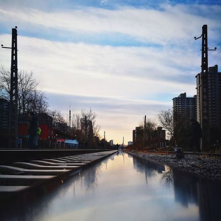 Reflection Architecture Sky No People Outdoors Built Structure Building Exterior City Day Tree Rail Transportation City Life Modern Freshness Tranquil Scene Diminishing Perspective The Way Forward Huawei P9 Photos Street Photography Beijing, China Mirrored Reflection Railroad Track Reflection Shadows & Lights Silhouette