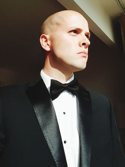 Young man in suit looking away