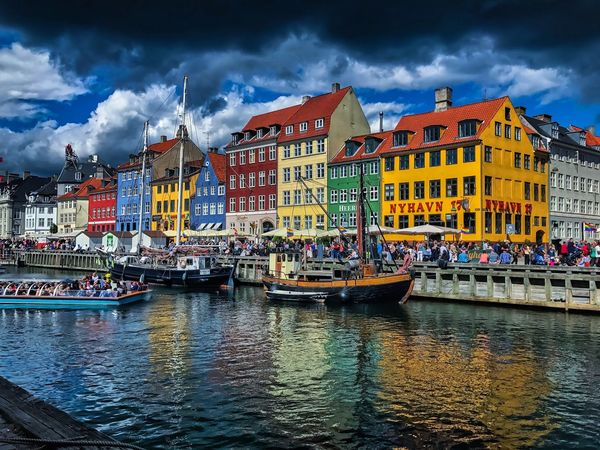 Copenaghen - Denmark Water Beautiful Denmark Europe Photography Copenhagen Architecture Building Exterior Built Structure Cloud - Sky Sky Waterfront Water City Outdoors River Day Town People Residential Building Nautical Vessel EyeEmNewHere EyeEmNewHere