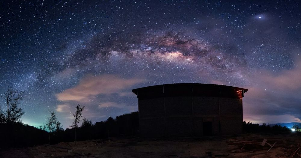 Silhouette Built Structure Against Star Field