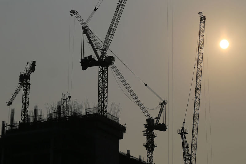 Large construction cranes are building high-rise buildings in the evening,Picture of silhouette style. Construction Cranes Building High Rise Buildings Evening Picture Silhouette Style Site Architecture Sky Tower City Steel Industrial Urban Industry Structure Activity Skyscraper Business House Frame Equipment Work High London Exterior Scaffolding Modern Estate Tall Development Engineering Concrete Project Built Sunset Color Yellow Cranes Technology Orange Outdoor New Outdoors Home Sun