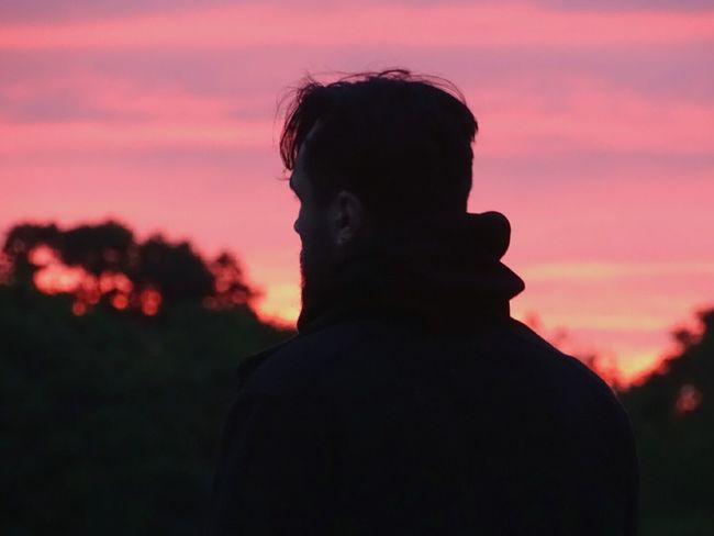 Silhouette Sunrise One Person Rear View Headshot One Man Only Cloud - Sky Nature Outdoors Eyeem Market EyeEm Getty Collection Dawn Tranquility Beauty In Nature Nature Landscape Silhouette Red Sky Place Of Heart