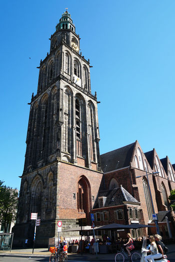 Martini church and tower Architecture Building Building Exterior Church City Clear Sky Cyclist Day Europe Groningen Holland Landmark Large Group Of People Martini Toren Martini Tower Netherlands Place Of Worship Real People Sightseeing Tourism Tower Travel