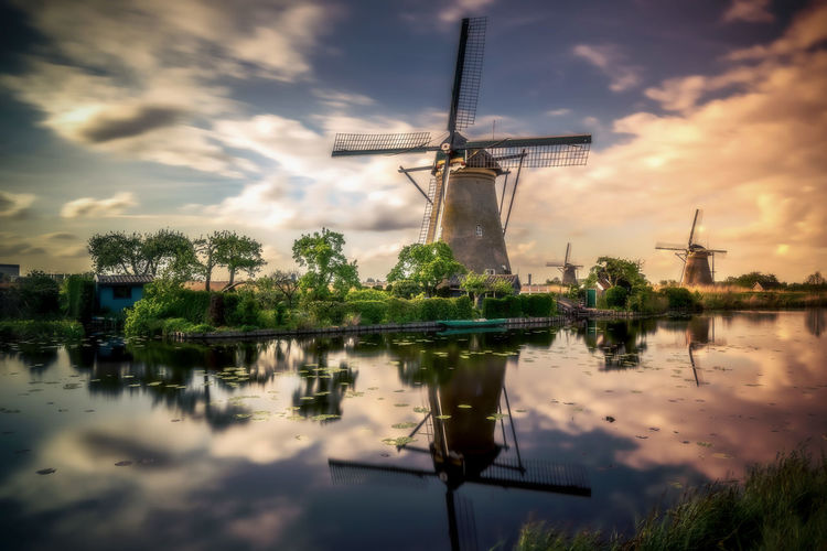 Remo SCarfo Amsterdam Kinderdijk Water Environmental Conservation Renewable Energy Turbine Sky Fuel And Power Generation Alternative Energy Wind Turbine Wind Power Reflection Cloud - Sky Traditional Windmill Environment Nature No People Lake Plant Waterfront Beauty In Nature Outdoors EyeEm Best Shots EyeEmNewHere