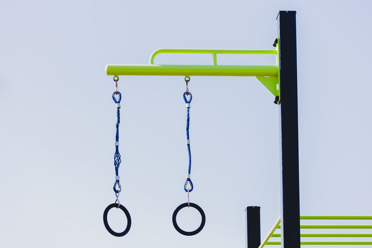 An outdoor gym with swings equipment. Still Life Photography Swing Set  Blue Close-up Equipment Fitness Fitness Training Green Color Gym Gym Time Healthy Lifestyle No People Outdoor Sport Sports Equipment Sports Photography Still Still Life Swing Workout