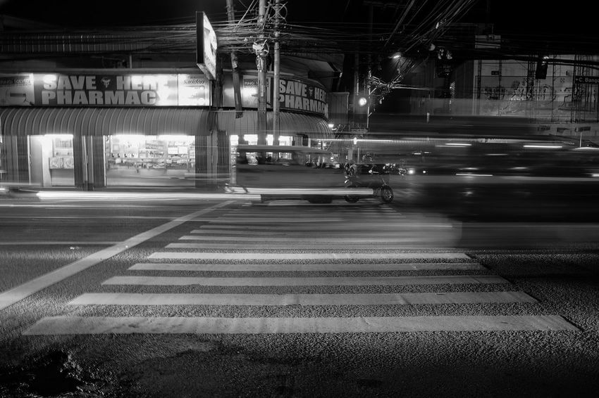 We live in a fast-paces society. Walking slows us down. Transportation Rail Transportation Railroad Track Railroad Station Railroad Station Platform Train - Vehicle Public Transportation Illuminated No People Night Indoors  Architecture Philippines Trailing Lights Streets Outdoors POTD Check This Out Fujifilm Street Photo City Black And White