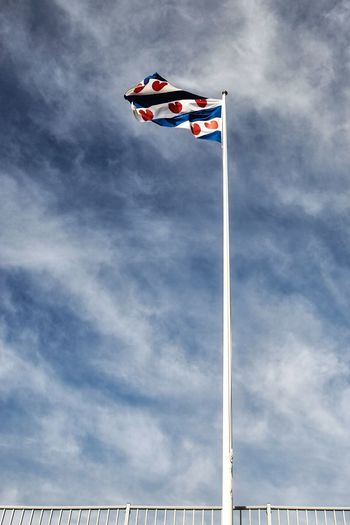 Fryslan boppe Patriotism Cloud - Sky Sky Flag Nature Low Angle View Wind Outdoors Pole Waving National Icon No People Day Blue