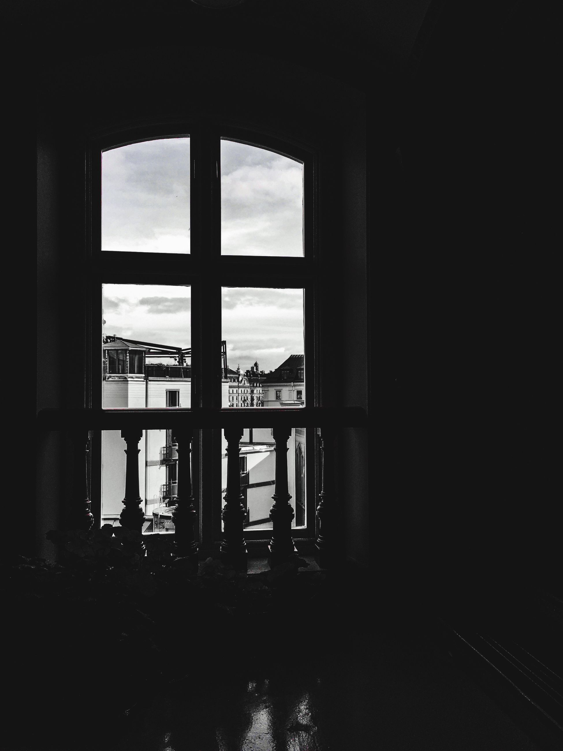 indoors, window, architecture, built structure, sea, water, sky, glass - material, silhouette, transparent, horizon over water, day, reflection, no people, sunlight, cloud - sky, dark, tranquility, empty, absence