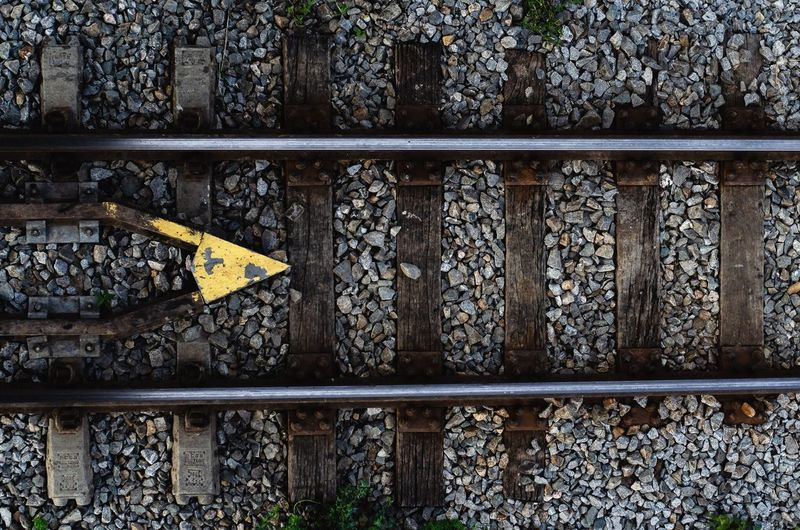 Railroad tracks No People Day Sign Communication Outdoors Plant Metal Text Railing Rail Transportation Track Tree Architecture Railroad Track Pattern Built Structure Nature Close-up Guidance Symbol