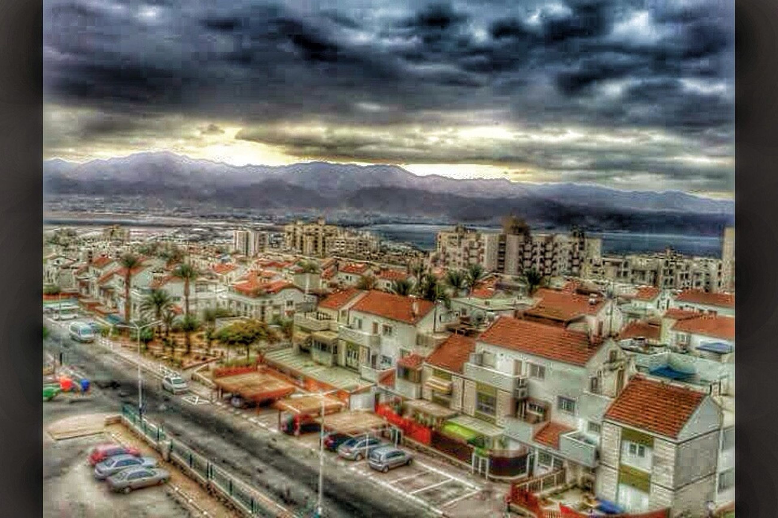 building exterior, sky, architecture, cloud - sky, built structure, city, cityscape, cloudy, mountain, residential district, residential structure, residential building, cloud, crowded, high angle view, townscape, sunset, town, house, car