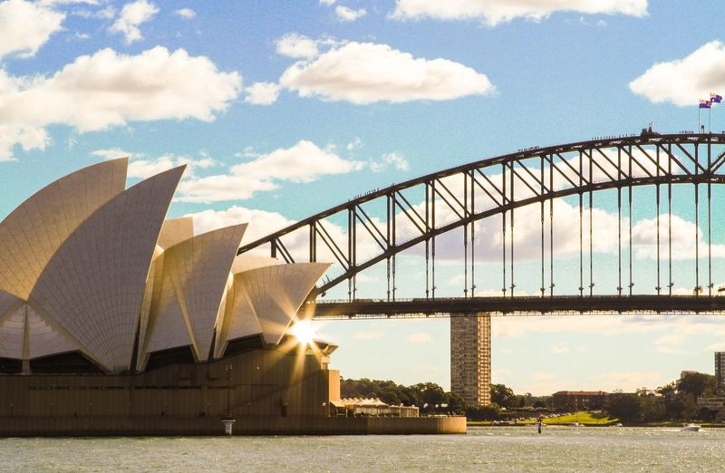Bridge - Man Made Structure Architecture Built Structure Cloud - Sky River Travel Destinations Travelling Travel Sunlight No People Building Exterior Nature Sydney Sydney, Australia Operahouse Sydney Opera House Sydney Harbour Bridge Harbourbridge Traveling Travel Photography Magazine Live For The Story