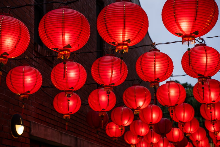 Beautiful round red lantern hanging on old traditional street, concept of chinese new year festival