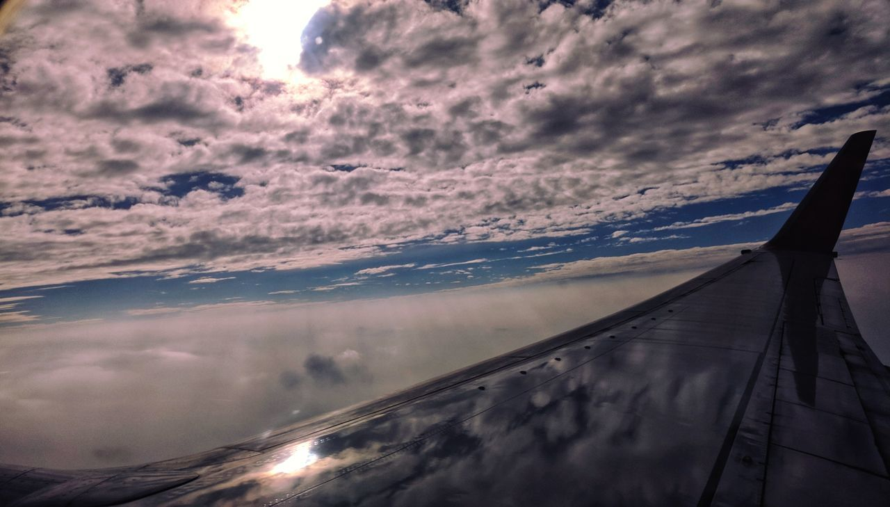 sky, cloud - sky, transportation, mode of transportation, airplane, air vehicle, no people, sunset, aircraft wing, flying, nature, beauty in nature, travel, scenics - nature, mid-air, motion, outdoors, public transportation, journey, glass - material