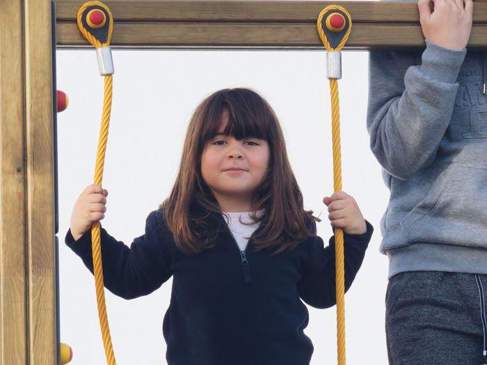 Portrait of girl holding play equipment
