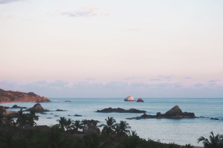 Scenic view of the beach in Mazunte, Mexico. Sunset lights Beach Beauty In Nature Central America Day Mazunte Mexico Nature No People Oaxaca Outdoors Pacific Pacific Ocean Scenic View Scenics Sea Sky Sunset Light Tranquil Scene Tranquility Tranquility Travel Destinations Water