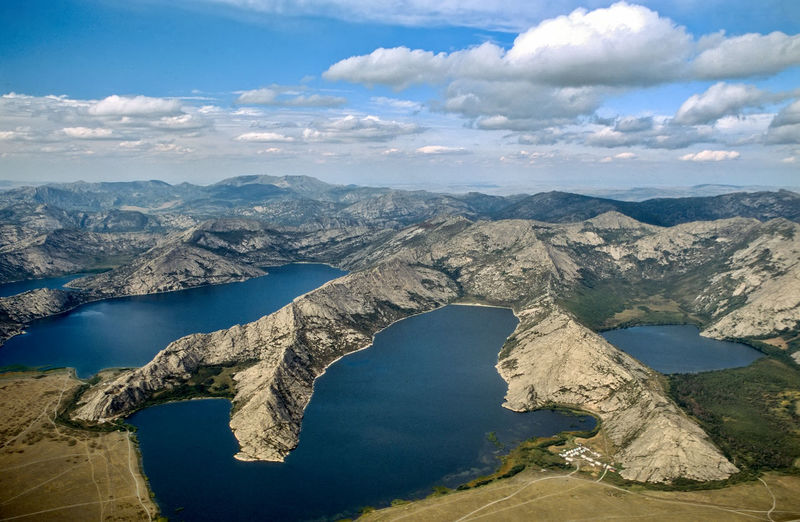 Aerial view of lake and mountains against sky. sibiny. kazakhstan