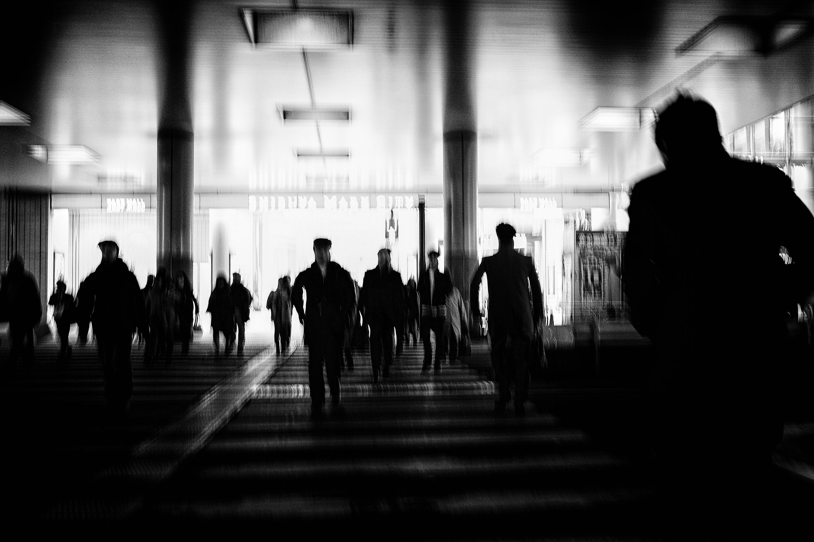 group of people, real people, silhouette, large group of people, walking, indoors, men, architecture, transportation, lifestyles, crowd, women, travel, leisure activity, built structure, day, adult, motion, full length, waiting