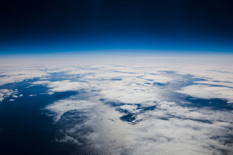 Sky Planet Earth Space Cloud - Sky Satellite View Blue Aerial View Planet - Space Nature Horizon Cloudscape Urban Skyline Environment Scenics - Nature No People Beauty In Nature Astronomy Atmosphere Tranquility Above Outdoors Meteorology Dark