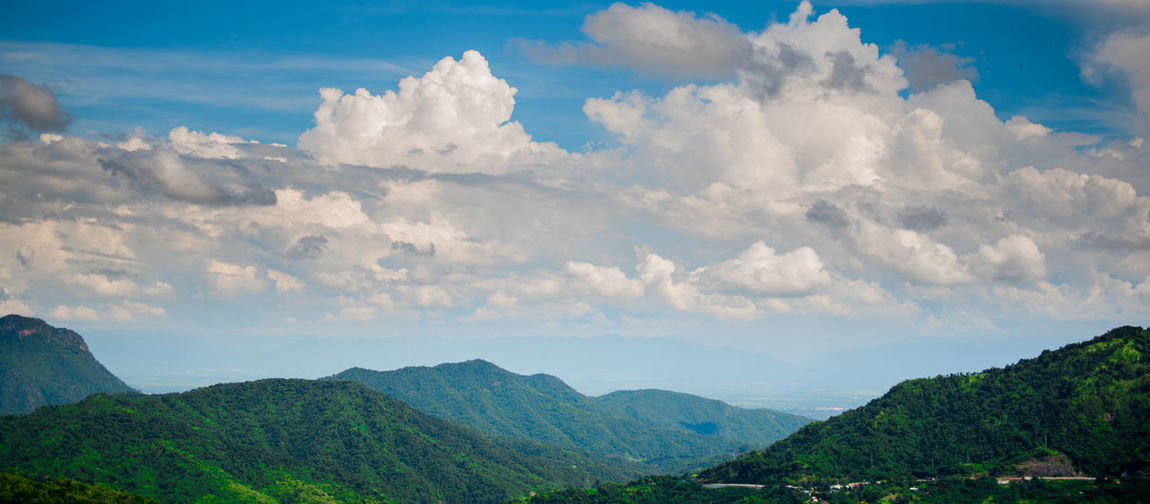 Cloud - Sky Scenics - Nature Beauty In Nature Sky Mountain Tranquil Scene Tranquility Mountain Range Environment Non-urban Scene Nature Landscape Idyllic Day No People Green Color Tree Plant Outdoors Remote Mountain Peak