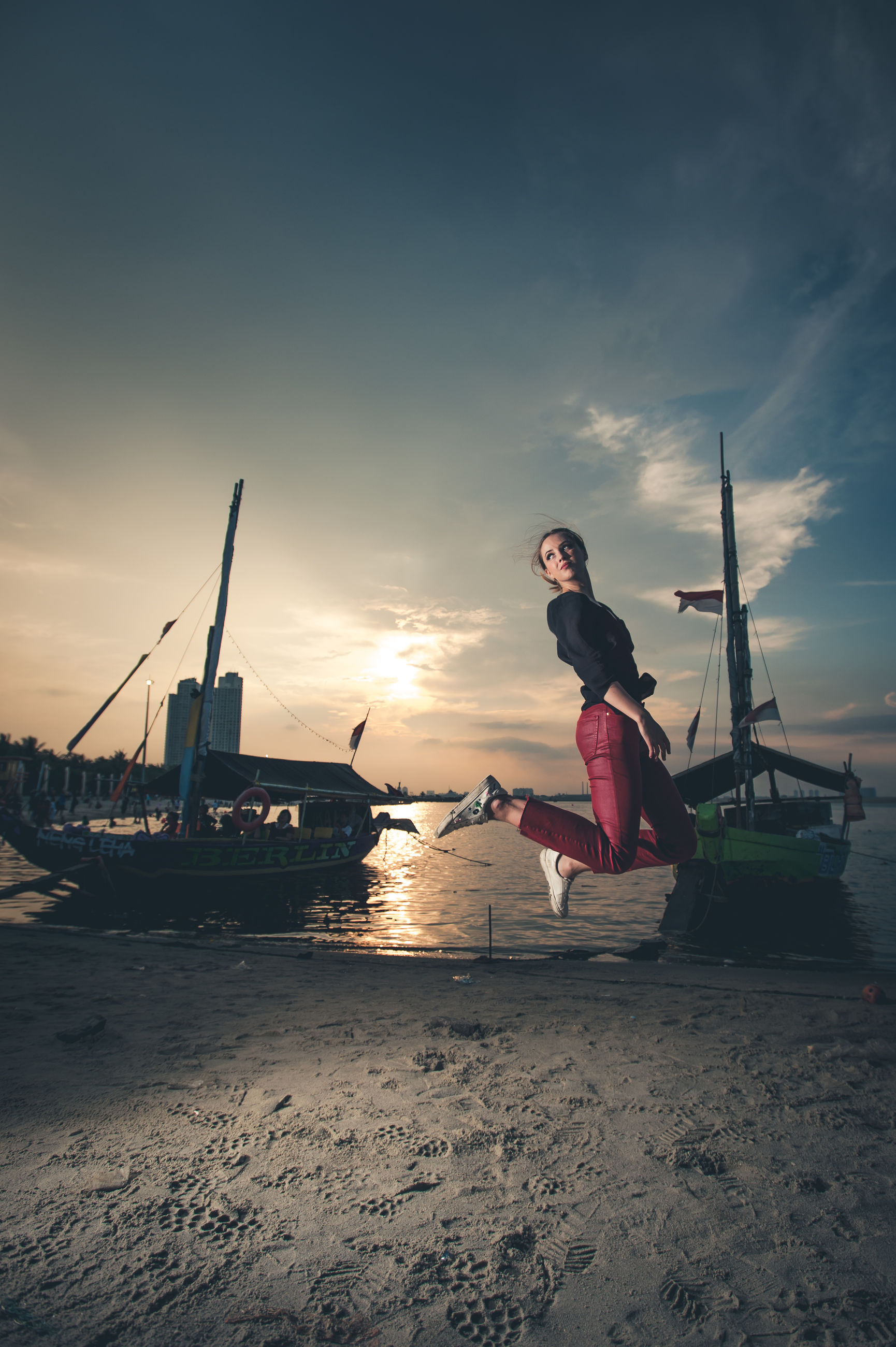 sky, nautical vessel, water, transportation, sea, mode of transportation, sunset, cloud - sky, one person, real people, nature, beach, land, full length, lifestyles, beauty in nature, outdoors, leisure activity