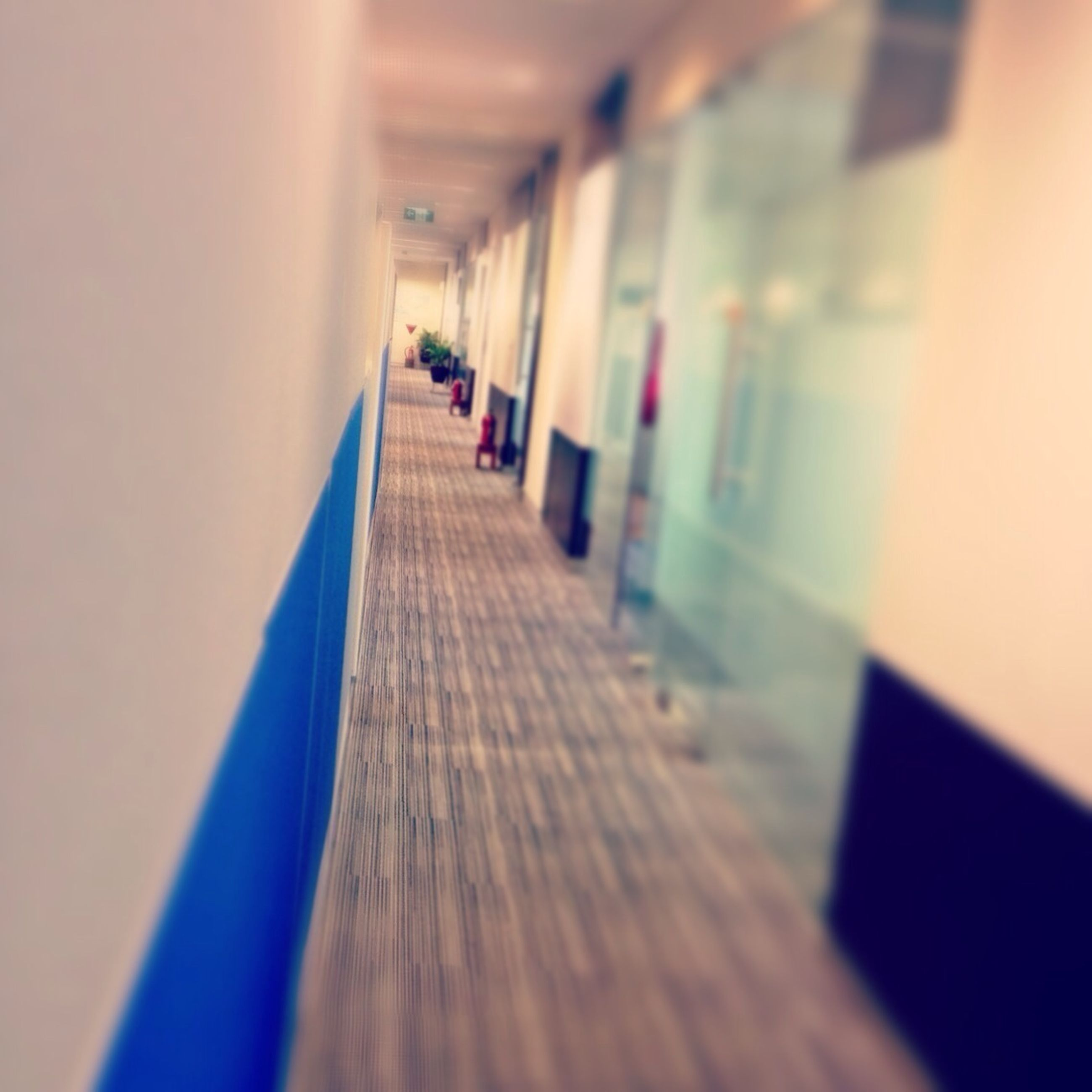 indoors, the way forward, in a row, architecture, diminishing perspective, corridor, built structure, empty, selective focus, narrow, vanishing point, surface level, absence, railing, long, steps, no people, flooring, wood - material, wall - building feature