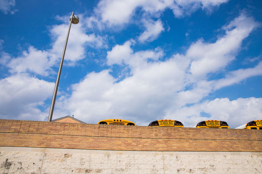 school bus on Sunday Student TOWNSCAPE Architecture Blue Sky Bus Cloud - Sky Day Low Angle View No People Outdoors School Sky Street Streetphotography Study Town Stories From The City