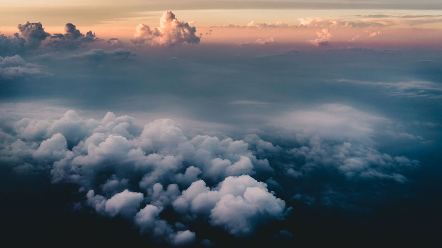 Beautiful colored cloudscape from above Clouds, Nature, My View Clouds Top Of Clouds In The Sky Above The Clous Fluffy Clouds Moody Sky Sunset Sunset Above Clouds Airplane Looking Out Airpla Dramatic Sky Dramatic Colorful Blue Orange Color Blue And Orange Cloudscape Cloud - Sky Sky No People Beauty In Nature Scenics - Nature Nature Tranquility
