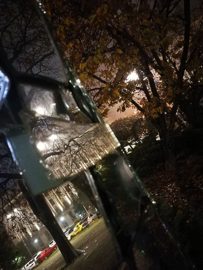 Citylights Week On Eyeem Bucharest Night Reflection Cityscapes Architecture Built Structure City Glass Reflection Outdoors Illuminated No People Connected By Travel
