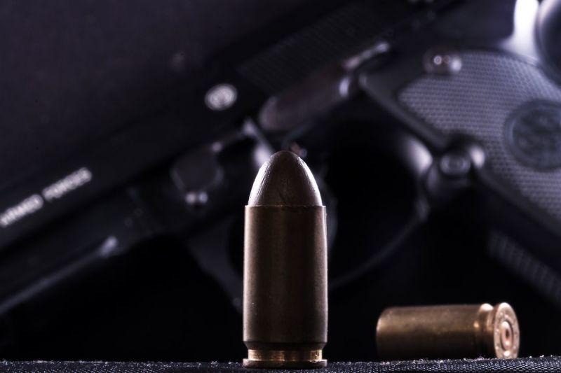 Close-Up Of Bullets And Gun