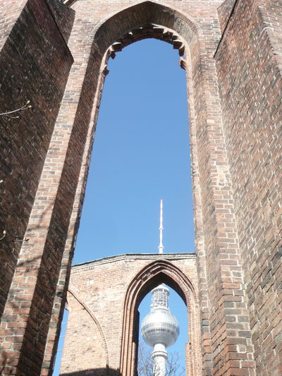 Arch Architecture Break The Mold Building Exterior Built Structure Church Ruins Clear Sky Gothic Window In Berlin Germany Low Angle View No People Outdoors Red Brick Architecture Sky TelecommunicationTower Window